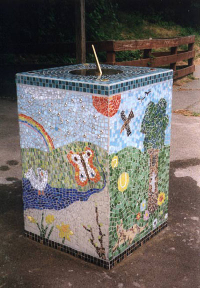 sundial on mosaic plinth