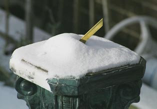 sundial covered with snow